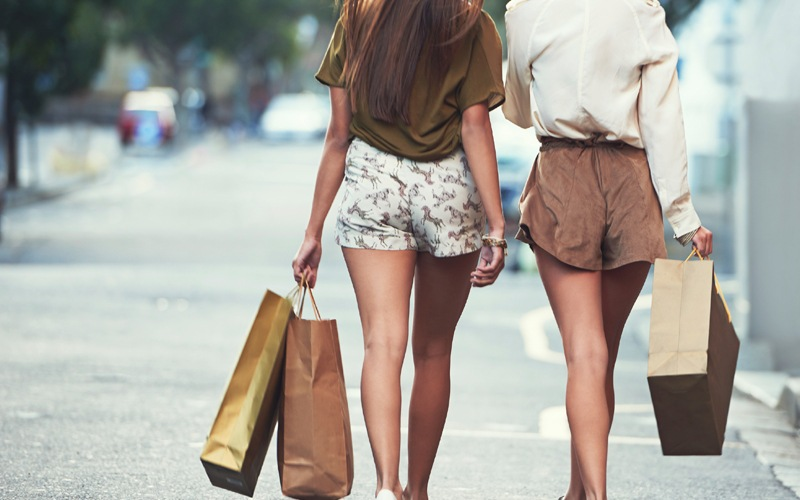 Girls walking with shopping bags